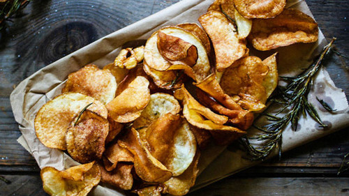 Homemade garlic and rosemary potato chips